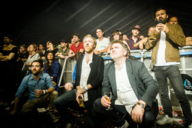 Pukkelpop 2016, Band members of LCD Soundsystem watch the performance of Stephen and David Dewaele from Soulwax.